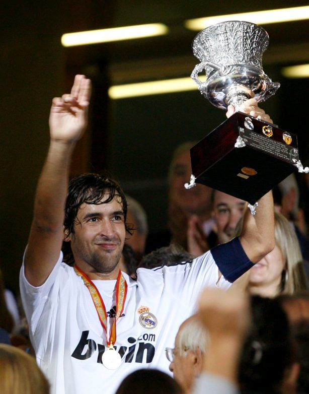 Raul and the Supercup trophy.